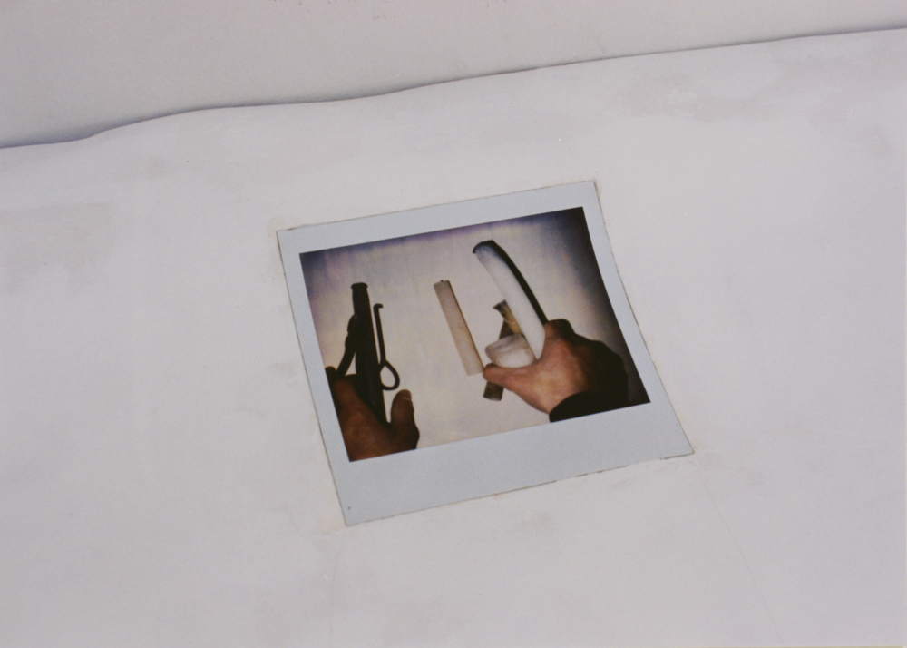 attila szucs, dual structure of people, detail, gypsum, wood, polaroid photo, 81x42x7cm. 1993